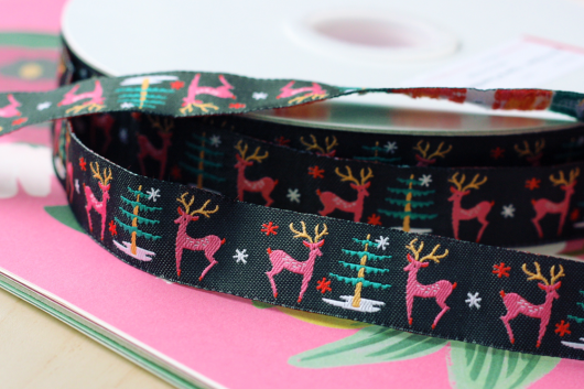 Cute deer holiday ribbon design